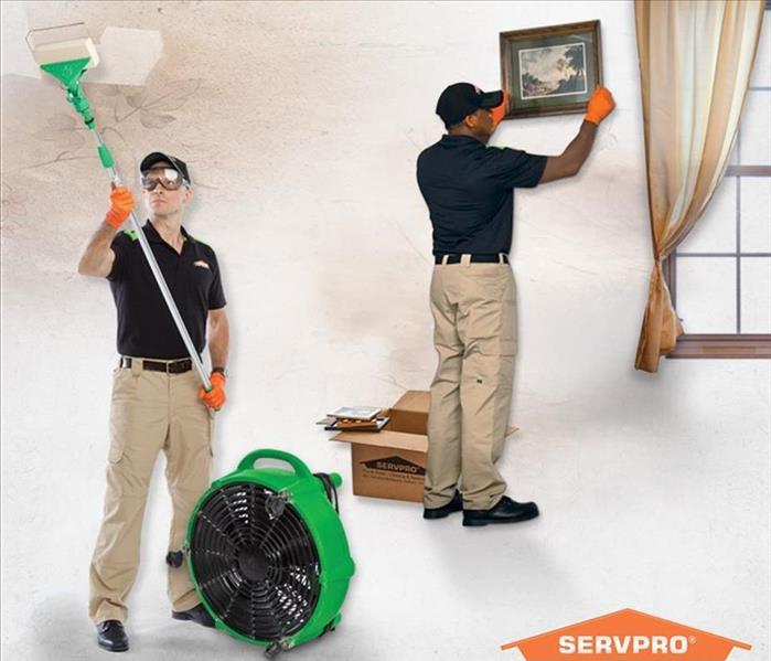 SERVPRO Technicians cleaning in a home.