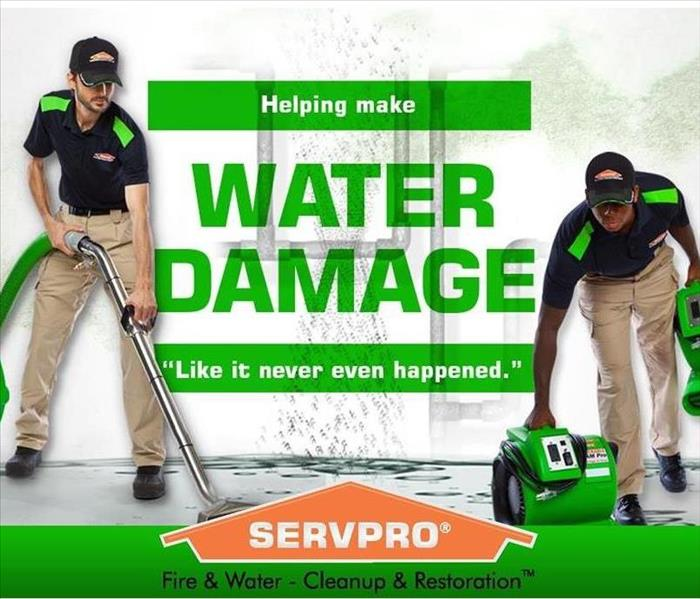 Two SERVPRO Technicians with equipment.