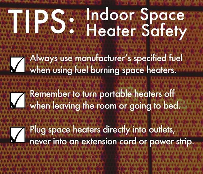 Space heater element with writing over it with safety tips.