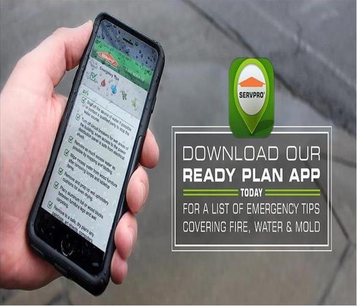 Hand holding a mobile phone with the SERVPRO Ready plan APP