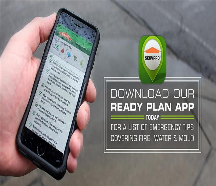 Persons hand holding a mobile device with the SERVPRO Ready Plan App on the screen.
